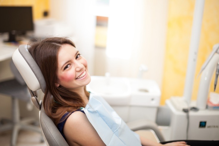 dental patient smiling in a dental clinic exam room