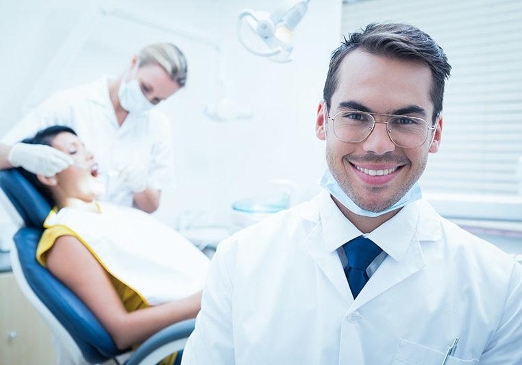 smiling male dentist is Edmonton, AB